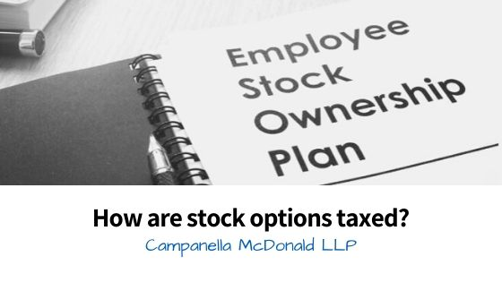 How are stock options taxed?